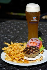 It's hard to go wrong with a beer and a Greek lamb with tzatziki and feta cheese burger at Coasters Pub and Biergarten in the Indian Harbour Beach.