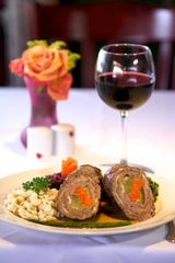 Heidelberg Restaurant in Cocoa Beach serves classic European-style dishes like this Angus beef stuffed with pickles, carrots, prosciutto, mustard and caramelized onion and served with spaetzle and red cabbage.