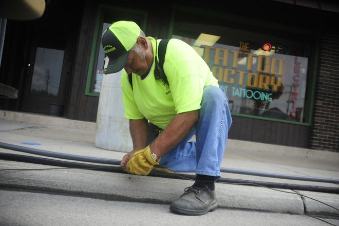 Joe Kennedy connects a grounding wire Wednesday at the Bucyrus Bratwurst Festival. Kennedy has helped with the festival since 1981.