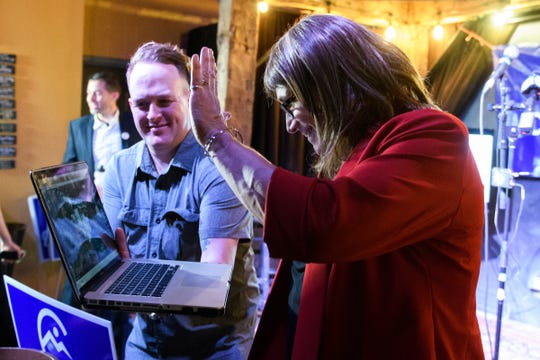 Christine Hallquist talks to her daughter in San Francisco  during the Primary party for the Democratic candidate for governor at the Skinny Pancake on Tuesday night August 14, 2018 in Burlington.