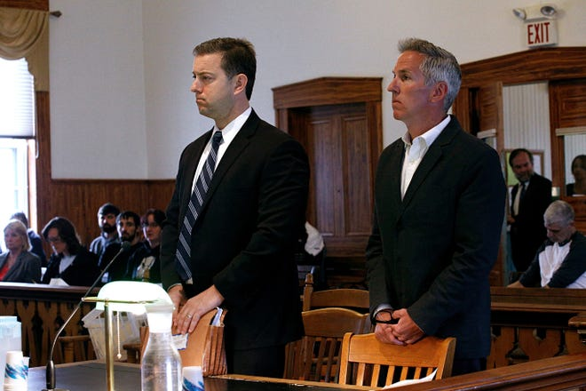 Former Randolph Union High School Co-Principal David Barnett, right, stands with his attorney, Brooks McArthur, as Barnett is arraigned on a charge of sexual exploitation of a minor at Orange Superior Court in Chelsea, Vt., on April 25, 2018. A former student disclosed an accusation of abuse which set off an investigation. (Valley News - Geoff Hansen) Copyright Valley News. May not be reprinted or used online without permission. Send requests to permission@vnews.com.