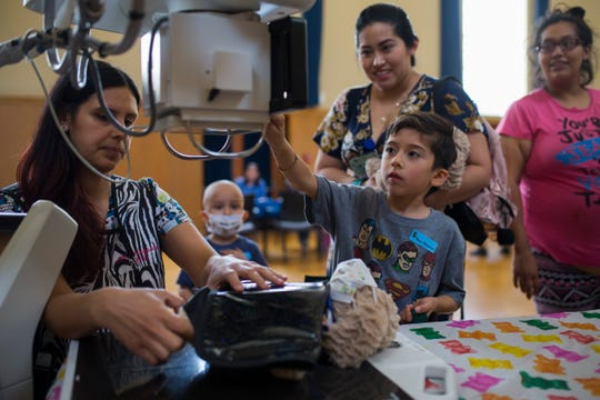 Gael Cisneros, 5, performs an X-ray on his bear during the Teddy Bear Hospital event organized by the Stripes Child Life Program on Wednesday, Aug. 15, 2018 at Driscoll Children's Hospital.