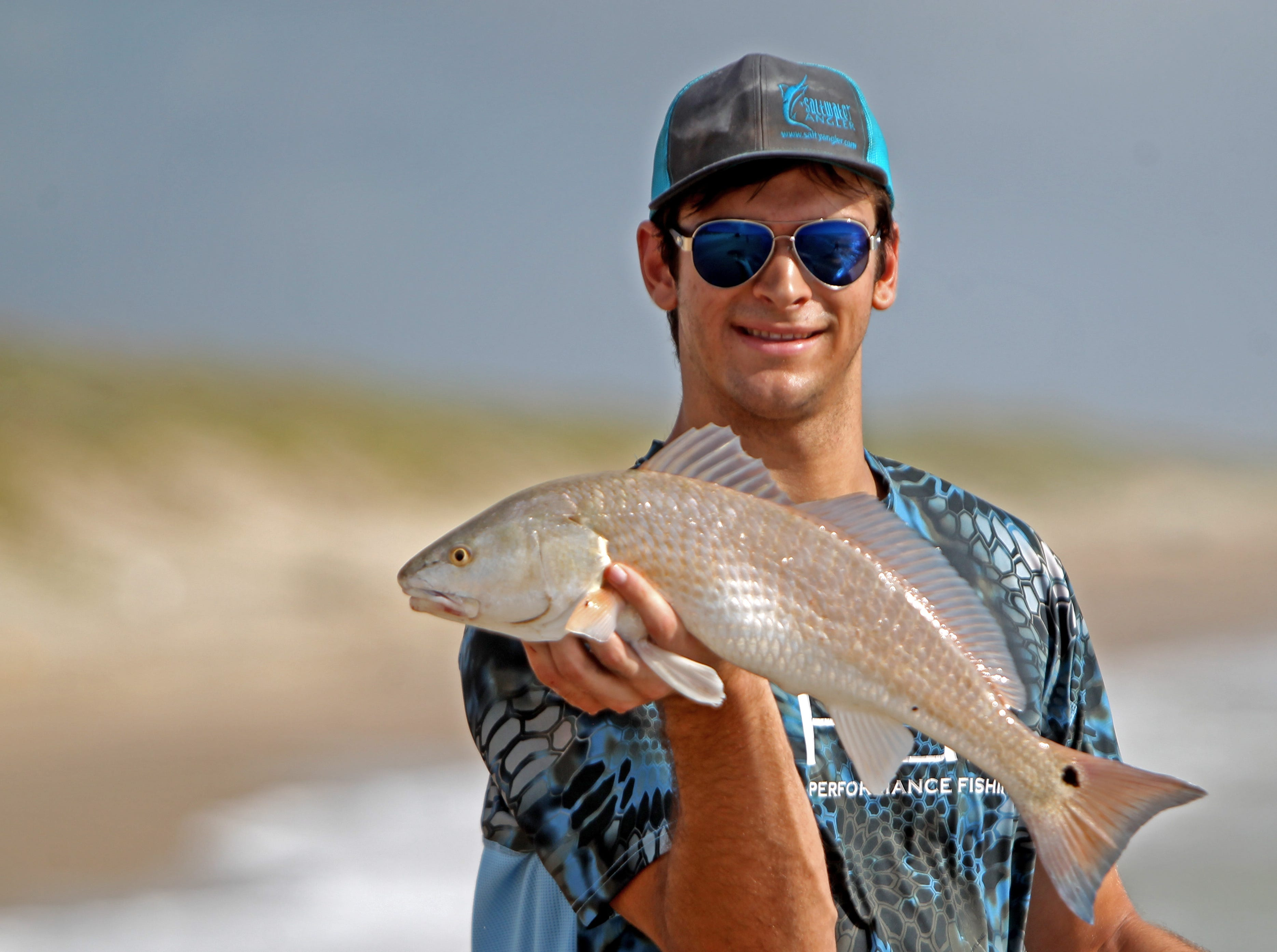 Luke McGhee caught this redfish on a silver spoon.