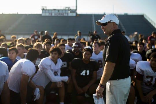 Flour Bluff head football coach Chris Steinbruck speaks with his  team following practice on Wednesday, August 15, 2018 at Flour Bluff High School.