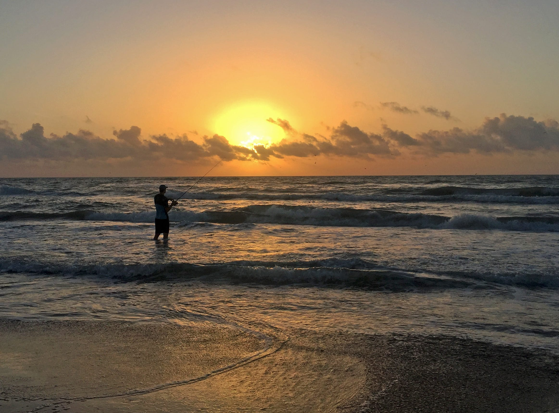 Luke McGhee enjoys a sunrise wade on Padre Island National Seashore.