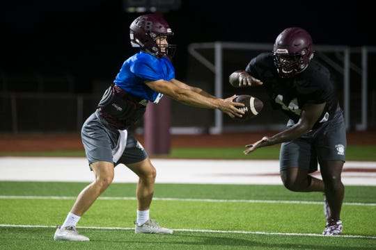 Flour Bluff's Javaris Lawson and quarterback Braden Sherron work on hand offs during practice on Wednesday , August 15, 2018 at Flour Bluff High School.
