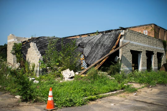 A crumbling building at the Camden Labs site Wednesday, Aug. 15, 2018 in Camden, N.J. The former toxic and illegal dumping site will be cleaned and cleared to make way for recreational open space.