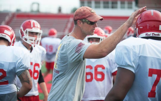 Rancocas Valley's football coach Dan Haussman  instructs his players during a practice on August 8, 2018.