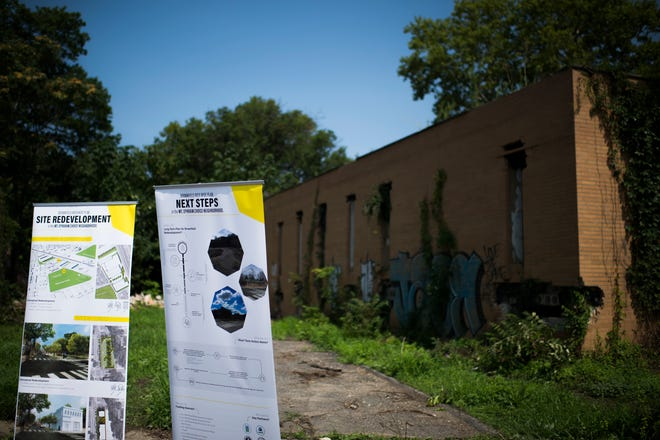 Posters outlining plans for the area are placed during a press conference at the Camden Labs site Wednesday, Aug. 15, 2018 in Camden, N.J. The former toxic and illegal dumping site will be cleaned and cleared to make way for recreational open space.
