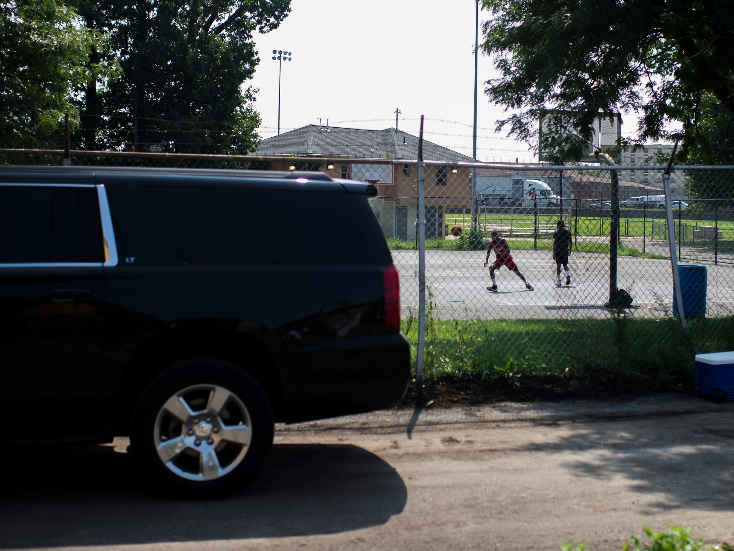 A pickup game is played next to the run-down Camden Labs site Wednesday, Aug. 15, 2018 in Camden, N.J. The former toxic and illegal dumping site will be cleaned and cleared to make way for recreational open space.