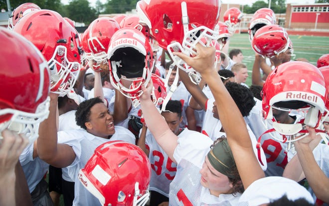 Rancocas Valley High School football players huddle up during a practice on August 8, 2018.