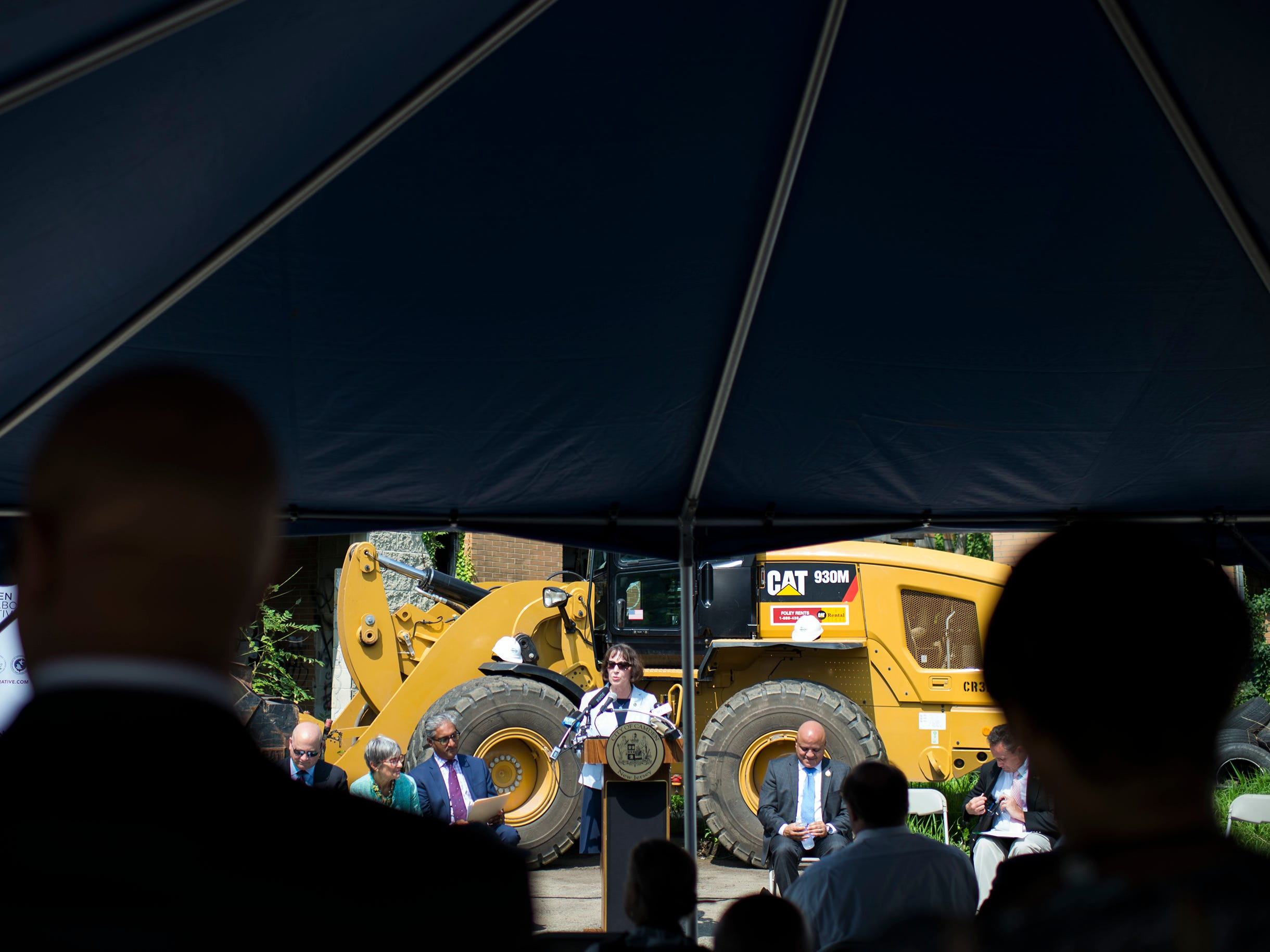 A press conference is held at the Camden Labs site Wednesday, Aug. 15, 2018 in Camden, N.J. The former toxic and illegal dumping site will be cleaned and cleared to make way for recreational open space.