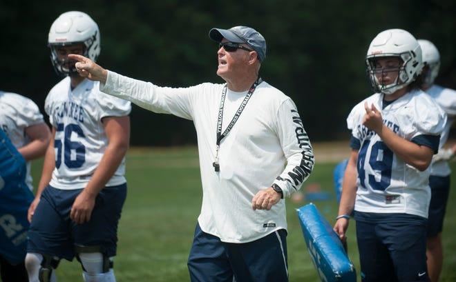 Shawnee football coach Tim Gushue instructs his players during football practice on August 9, 2018.