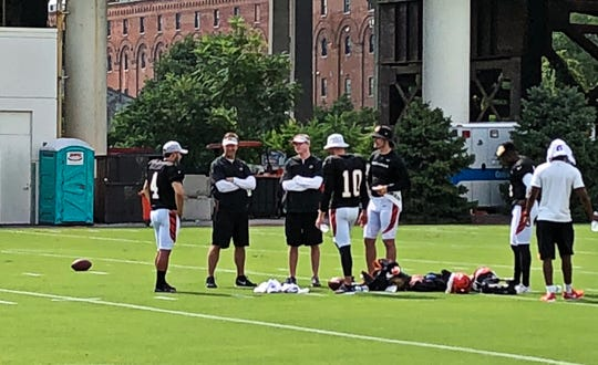 Equipment manager Mitch Bischoff, right, impersonates Bengals special teams coach Darrin Simmons, left, during training camp.