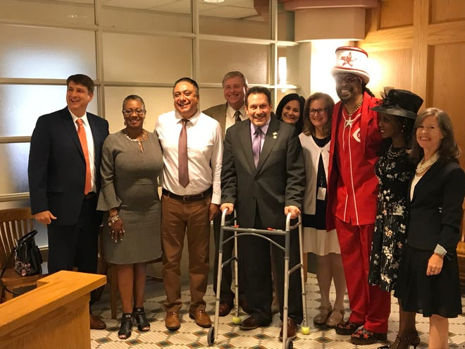 Bootsy and Patti Collins join the first Hamilton County Oral Health Coalition at the Hamilton County Commissioners meeting Aug. 15, 2018.