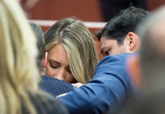 Family and friends of Ryan Poston tear up as the clothing he was wearing on October 12, 2012 is shown during the retrial Shayna Huber, 27. Hubers was originally convicted of shooting Poston six times in his Highland Heights condo and sentenced to 40 years in prison, but she was granted a retrial after her attorney discovered a juror in the first trial had a prior felony conviction. Campbell County Judge Daniel Zalla is the presiding judge.