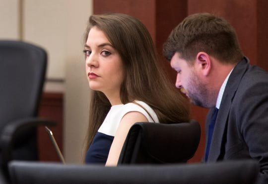 Shayna Hubers, 27, looks into the courtroom in the Campbell County Courtroom of Judge Daniel Zalla for her retrial in the shooting death of Ryan Poston, 29, on October 12, 2012 in his apartment in Highland Heights. Hubers, who was convicted in 2015 and sentenced to 40 years, was granted a retrial after her attorney discovered a juror in the first trial had a prior felony conviction.