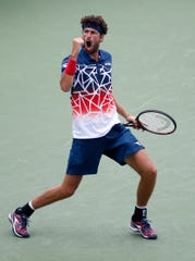 Robin Haase reacts to winning a point over Alexander Zverev during the 2nd round of the Western and Southern Open at the Lindner Family Tennis Center in Mason Wednesday August 15, 2018.