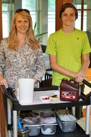 Nancy Fela Parenti (left) and son Matthew of Fanwood prepare to serve ice cream to patients and their loved ones at Peggy's House in Scotch Plains, one of the Center for Hope's hospice and palliative care residences.