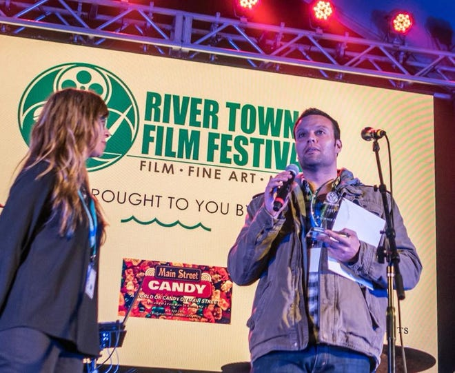 "John Burr, Director of Muse the Film and winner of the ""2017 Audience Choice Award"" with River Town Film Festival co-founder, Kee Kee Buckley"