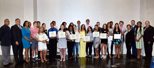 Union County Freeholder Chairman Sergio Granados and Freeholders Angel G. Estrada, Angela R. Garretson, Alexander Mirabella and Rebecca Williams present certificates to recent graduates recognizing the Valedictorians and Salutatorians from high schools across the county at the 2018 Union County Academic Excellence Dinner in Kenilworth. They were joined by Union County Undersheriff Mickey Colon and keynote speaker Afiya Rawls. At the dinner, presented by the Union County Board of Chosen Freeholders, 24 students from 17 high schools were honored.