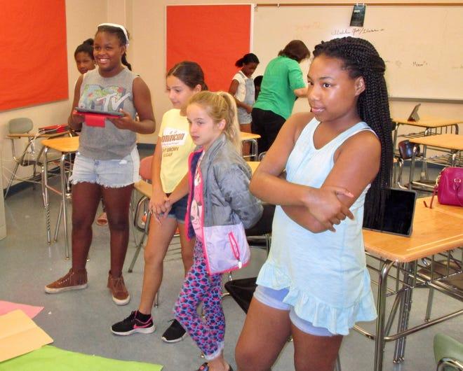 Alivia Collier (Grade 6, McManus), Giana Collado (Grade 6, McManus), Caela Jones (daughter of teacher Jennifer DeTrolio-Jones), and Laila Slater Halsey (Grade 6, McManus) taking turns working with the Sphero robot.