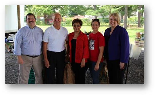 (Left to right) Rutgers Professor Dr. William Hallman, New Brunswick Mayor Jim Cahill, Nurgul Fitzgerald, Lauren Errickson andCommissioner Carole Johnson.
