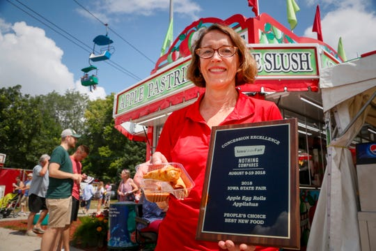 Connie Boesen, owner of Applishus, stands for a photo with her apple egg rolls, winner of the people's choice best new food at the Iowa State Fair Aug. 15, 2018.