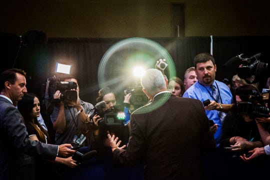 Vice President Mike Pence answers questions from the media after speaking at an America First Policies event on Wednesday, Aug. 15, 2018, at the Iowa Events Center in Des Moines.