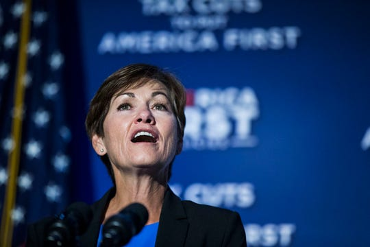 Gov. Kim Reynolds introduces Vice President Mike Pence on Wednesday, Aug. 15, 2018, during an America First Policies event in Des Moines.