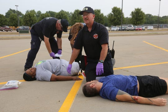 Indianola first responders treat the mock victims of an active shooter during a training exercise. The Indianola police and fire departments along with the Indianola Community School District and other law enforcement and first responder agencies conducted active shooter training at Indianola High School on Aug. 14.