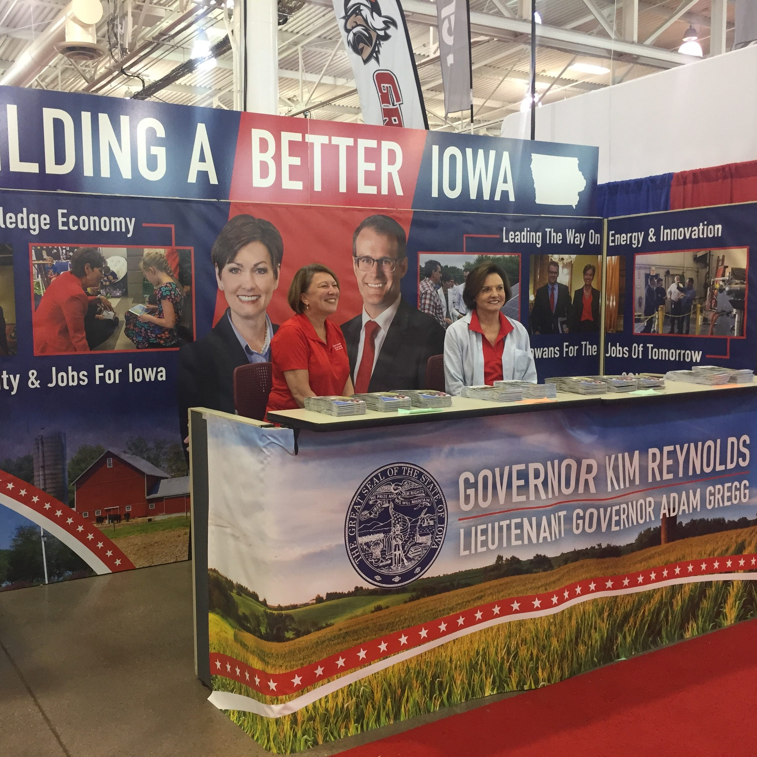 A booth for Iowa Gov. Kim Reynolds' campaign inside the Varied Industries Building at this year's Iowa State Fair.