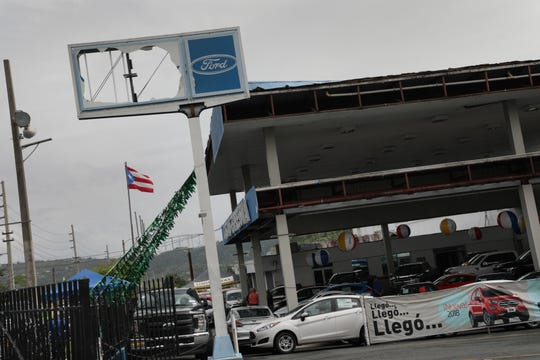 Damage to the Caguas Expressway Motors sign, a Ford dealer are still visible ten months after hurricane Maria hit Puerto Rico in Caguas on Thursday, July 26, 2018.