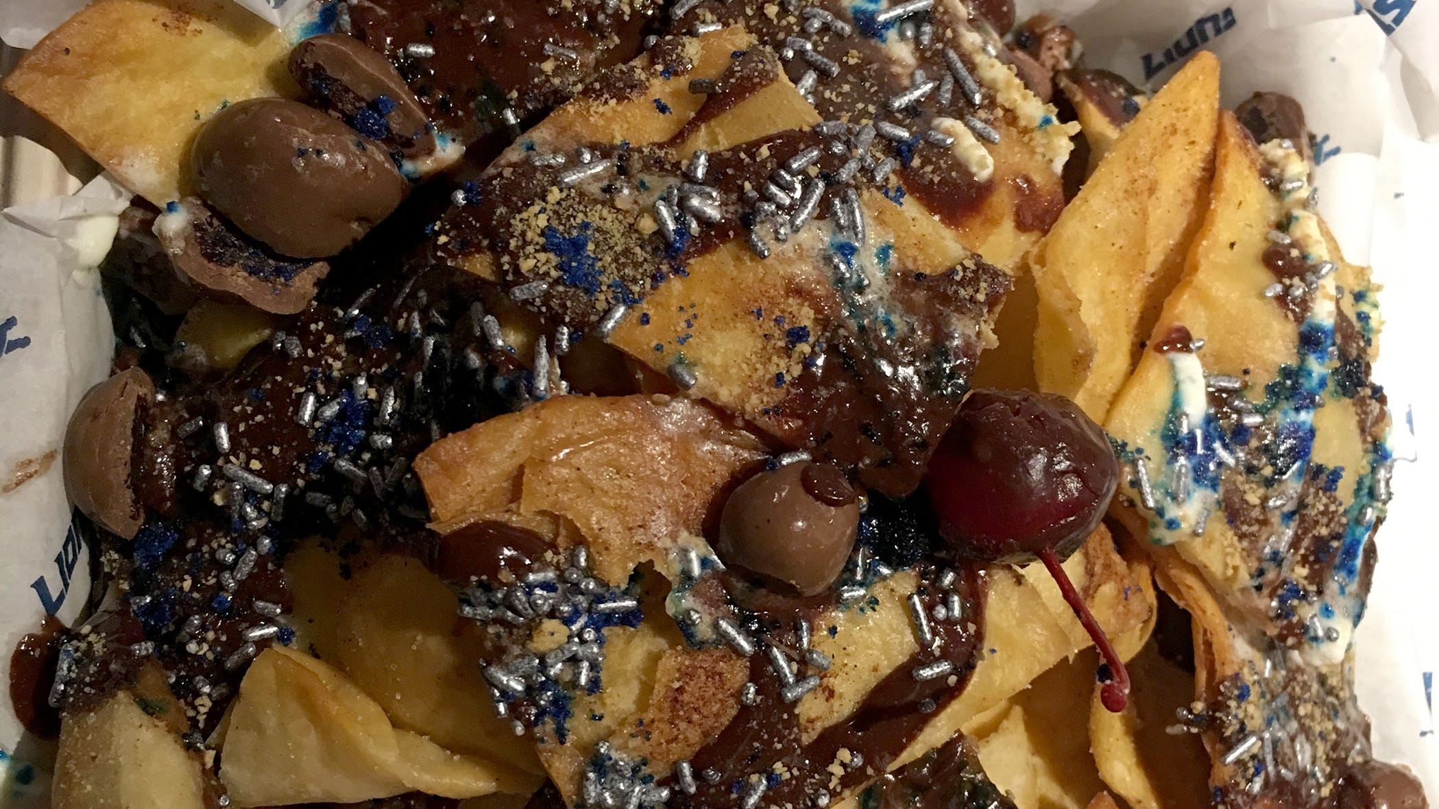 Michigan cherry chocolate nachos are topped with chocolate ganache, chocolate covered cherries, marshmallow fluff and nutella will be on the menu during Lions games at Ford Field in Detroit. The dish was photographed on Tuesday, August 14, 2018.