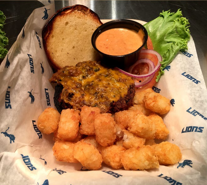 The Impossible Burger, a plant-based burger served with tater tots and a lime chipotle aioli will be on the menu during Lions games at Ford Field in Detroit.  The food was photographed on Tuesday, August 14, 2018.