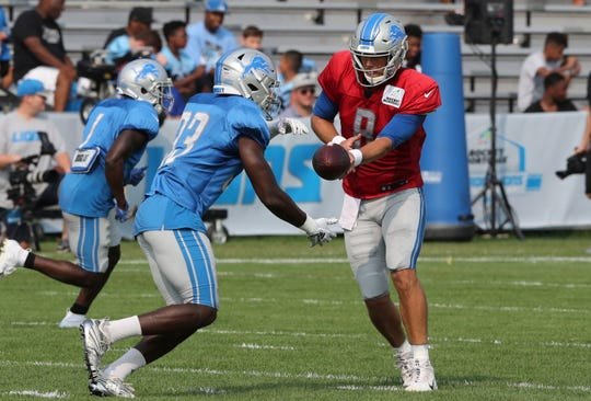 Lions quarterback Matt Cassel hands off to running back Kerryon Johnson during drills during practice on Wednesday, Aug. 15, 2018, in Allen Park.