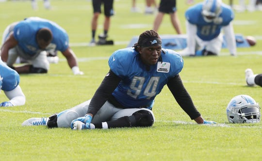 Lions defensive end Ziggy Ansah stretches during practice on Wednesday, Aug. 15, 2018, in Allen Park.