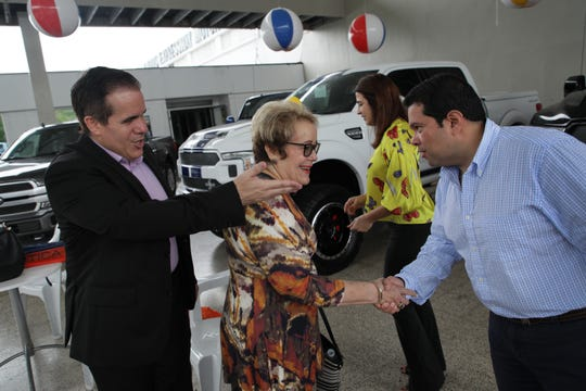 Julio Ortiz, vice president of Caguas Expressway Motors, from left introduces his mother Elva Mendez, president of Caguas Expressway Motors to Joe Avila of the Ford Fund at their Ford dealership in Caguas, Puerto Rico on Thursday, July 26, 2018.