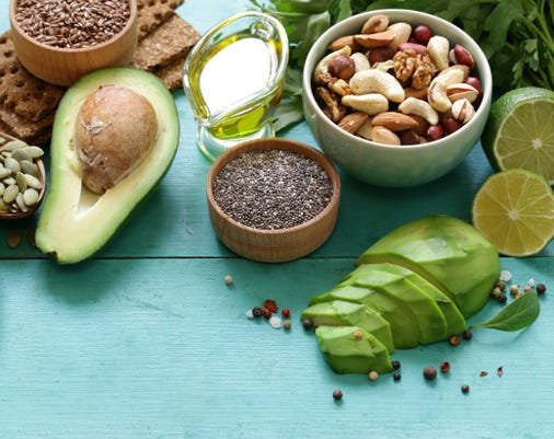 Healthy And Nutrition Food Avocado Chia And Flax Seeds Olive Oil And Vegetables