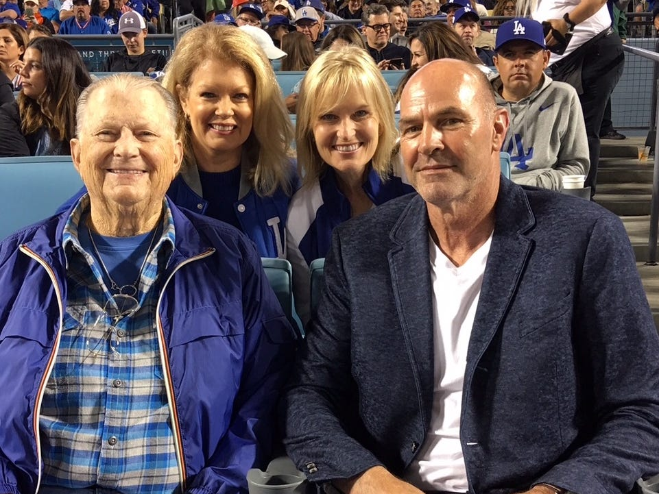 """Gibson in the stands at Dodger Stadium with, from left, film producer Burt Sugarman, former TV host Mary Hart and his wife JoAnn.""""I think his whole athletic life has prepared him for battling this,"""" JoAnn says. """"He looks at things as though they're a task and he wants to do it better than the next guy."""""""
