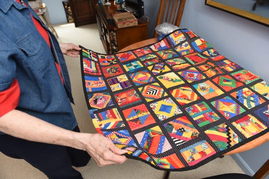 Muriel Jacobs, of Farmington Hills, shows off her free hand quilt titled Mind of it's Own.