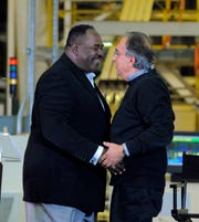 UAW vice president General Holiefieldand and FCA CEO Sergio Marchionne in 2012.