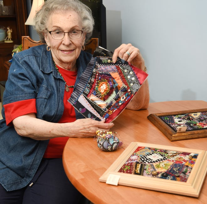 Muriel Jacobs, of Farmington Hills, shows one of her fabric collage projects.