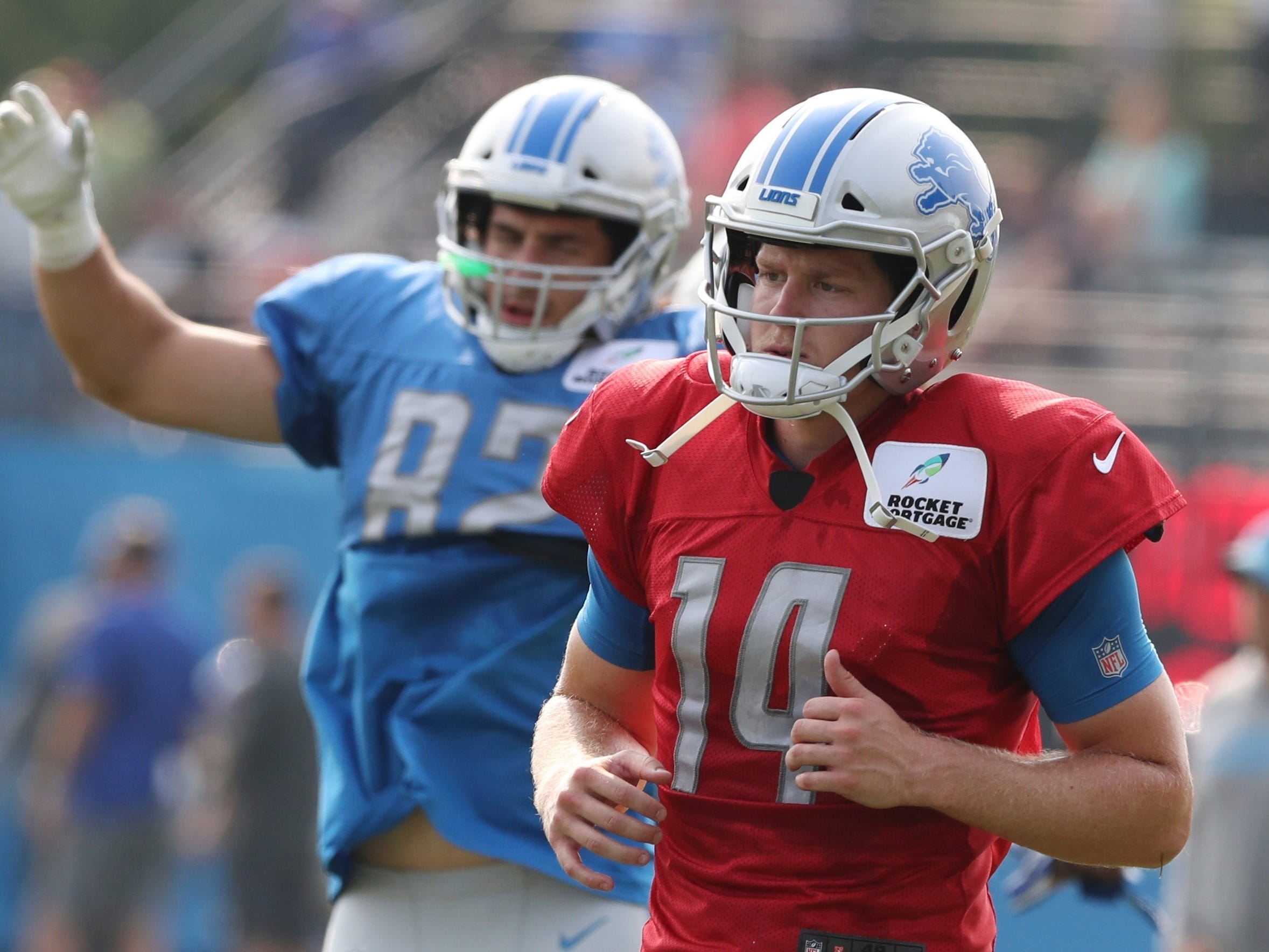 Detroit Lions quarterback Jake Rudock warms up before drills at the team's football camp.