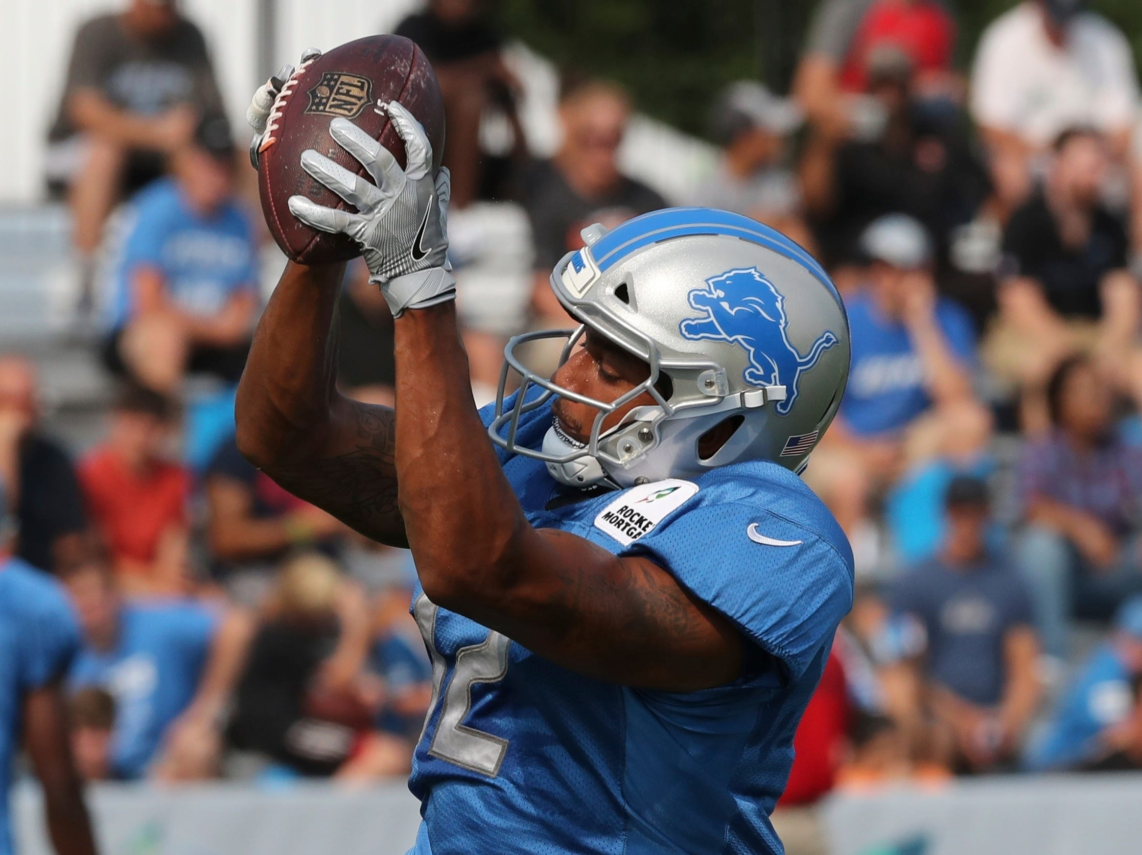 Detroit Lions receiver Bradley Marquez catches during a drill at the team's football camp.