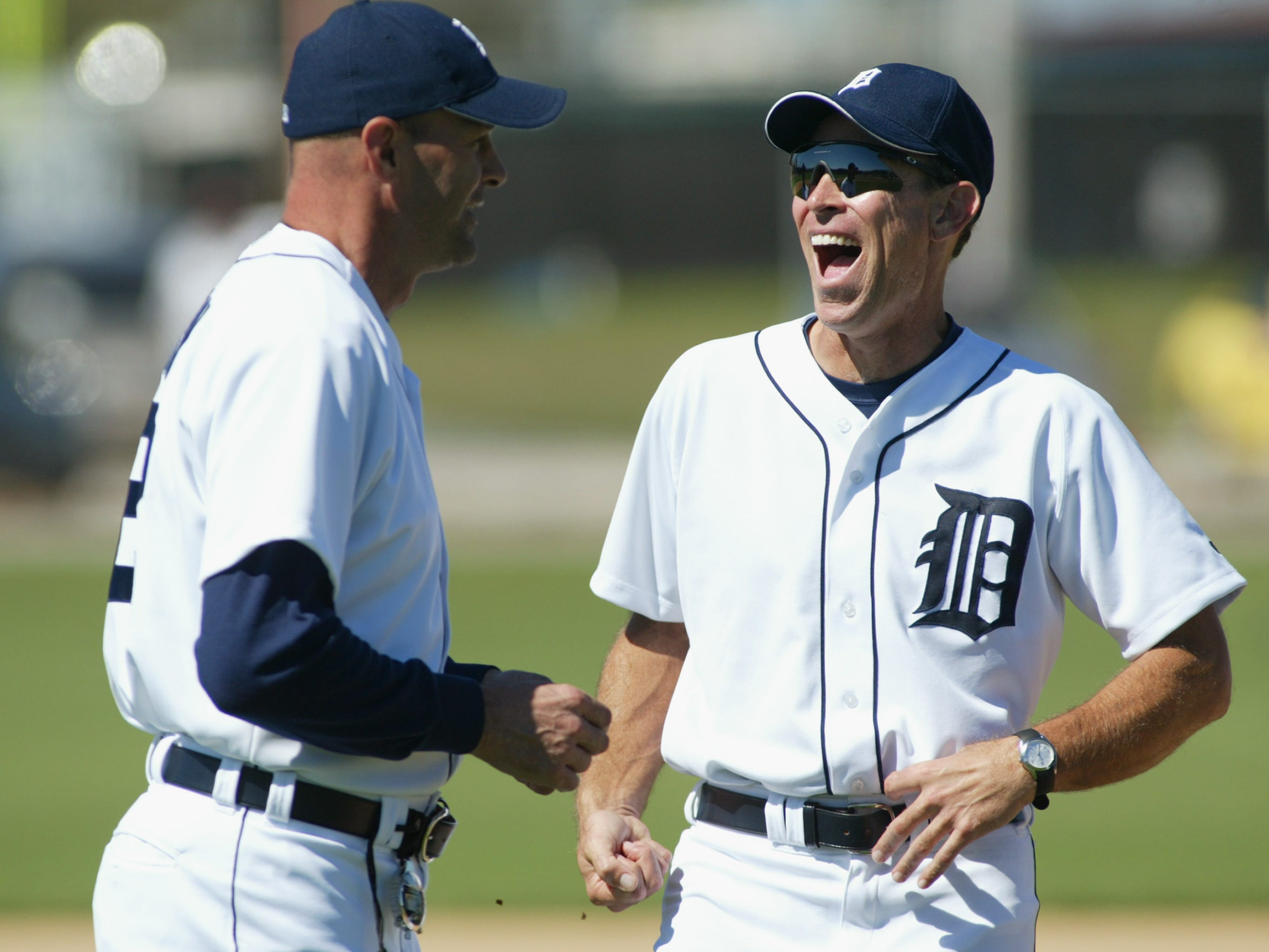 Longtime friends Kirk Gibson and  Alan Trammell joke during workouts at Tigertown on Feb. 23, 2003 in Lakeland, Florida. When Trammell managed the Tigers from 2003-05, Gibson was his bench coach. When Gibson managed the Diamondbacks from 2010-14, Trammell was his bench coach.