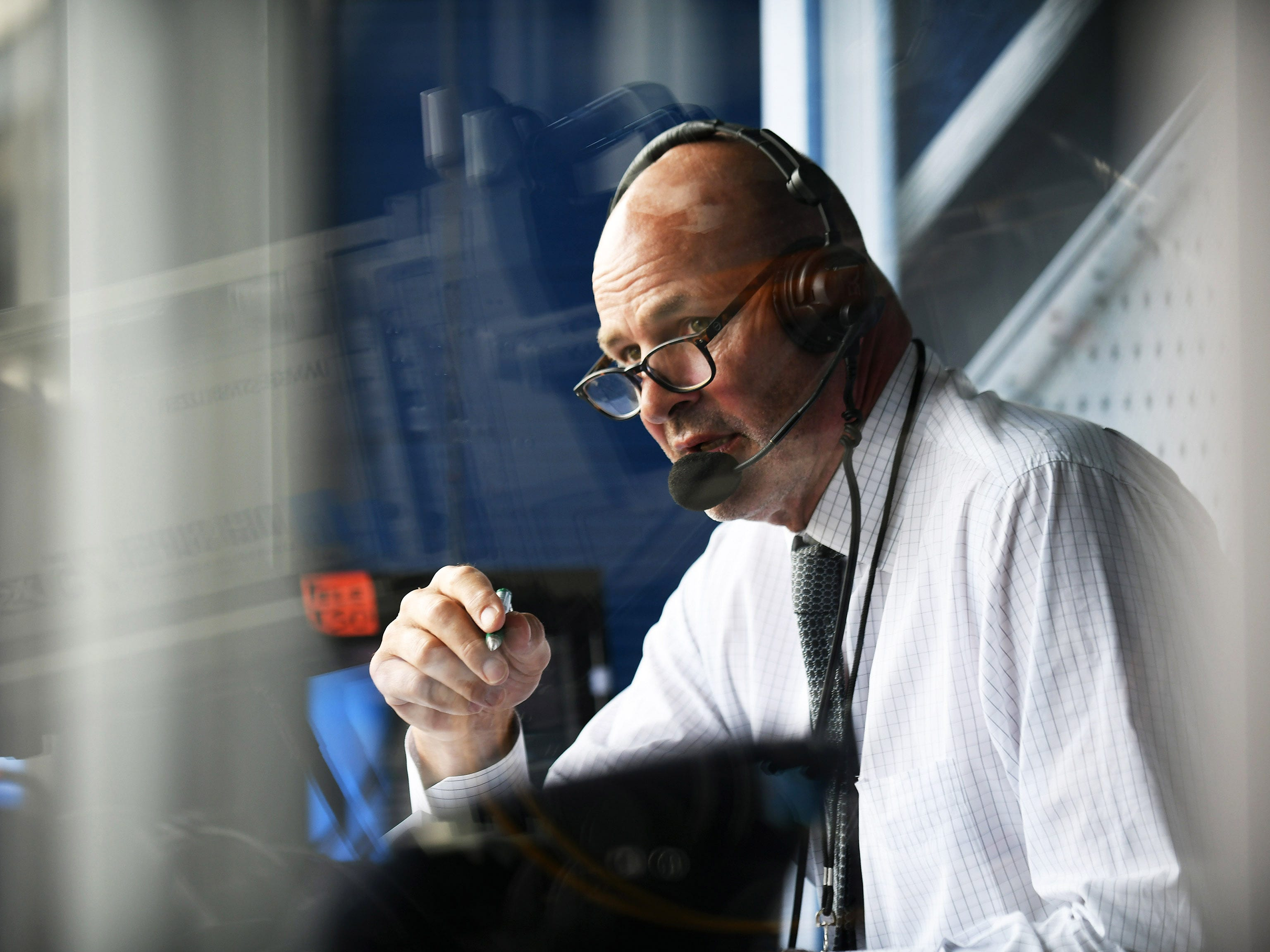 Kirk Gibson works in the FSD booth during a Tigers game against the Boston Red Sox at Comerica Park on July 20, 2018. He controls the symptoms of Parkinson's through medication, exercise and therapy, but he recognizes the deterioration won't stop. Neither will he.