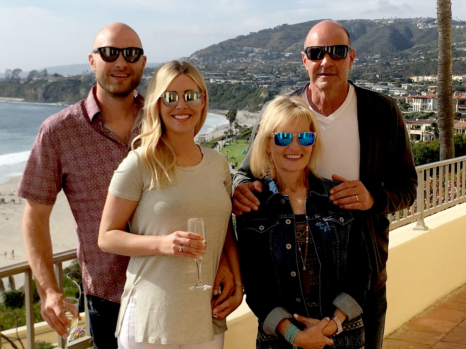 A family photo shows Gibson with his wife JoAnn, along with son Kirk Robert and his girlfriend Skylar.