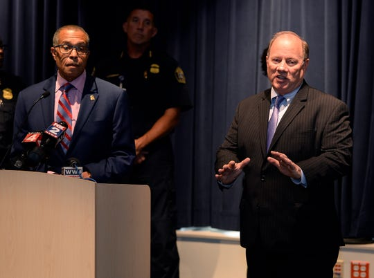 Detroit Mayor Mike Duggan, (r), stands with Detroit Police Chief James Craig at a press conference over the death of Detroit Police Officer Fadi Shukur who died August 15 after a hit-and-run August 4.