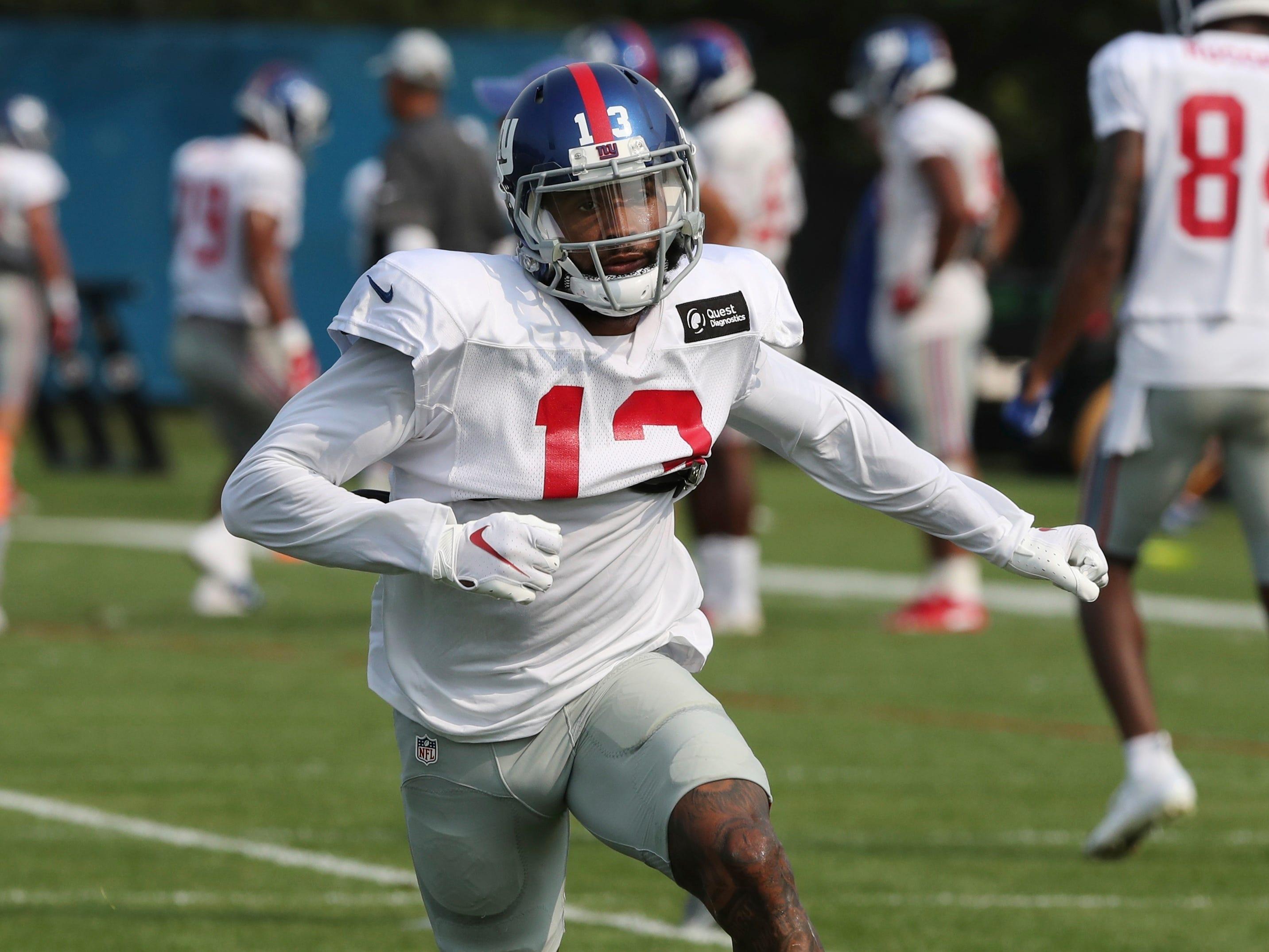 New York Giants receiver Odell Beckham Jr., runs through a drill at the Detroit Lions football camp.